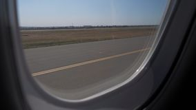 Airplane taking off from airport. View through the window of the aircraft stock footage