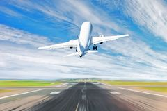 Airplane taking off from the airport - back view. Airplane taking off from the airport - back view royalty free stock image