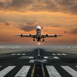 Airplane taking off from the airport. Royalty Free Stock Image
