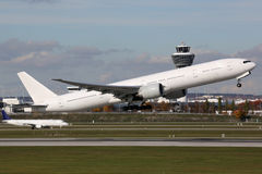 Airplane taking off at airport. An airplane is taking off at Munich airport stock photography