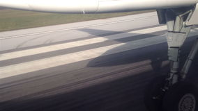 Airplane taking off from airport runway. View from the inside of an airplane taking off from airport runway in Zagreb, Croatia; with undercarriage retracting and stock video footage
