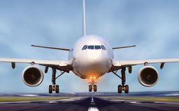 Airplane taking off from airport runway royalty free stock photo