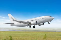 Airplane taking off from the airport, side view. Airplane taking off from the airport, side view royalty free stock images
