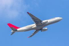 Airplane taking off. In the blue sky stock photo
