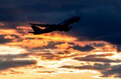 Airplane taking off. With clouds in the sky stock photos