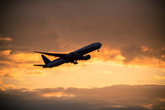 Airplane taking off. With clouds in the sky royalty free stock photography