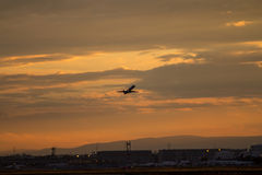 Airplane taking off. With clouds in the sky royalty free stock photos
