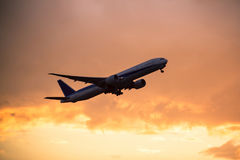 Airplane taking off. With clouds in the sky stock images