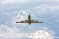 Airplane taking off in a dramatic sky. Airplane taking off in a somber sky Stock Image