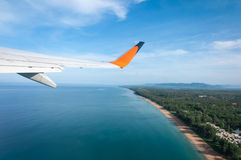 Airplane taking off from the island Stock Photos