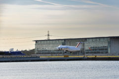 Airplane taking off from the London City Airport Royalty Free Stock Photo