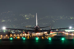 Airplane taking off in the night Stock Image