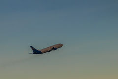 Airplane taking off from the runway airport, uprising with cloud. S in the blue sky background Stock Photo