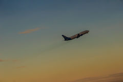 Airplane taking off from the runway airport, uprising with cloud. S in the blue sky background Royalty Free Stock Photos