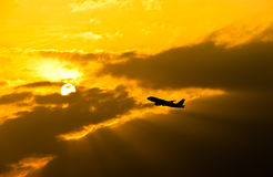 Airplane taking off at sunset Royalty Free Stock Photography