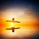 Airplane taking off at sunset Royalty Free Stock Image