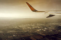 Airplane taking off. Wing of a commercial airplane upon takeoff from Valencia Stock Photography