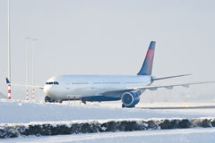 Airplane taxiing. Jet airplane taxiing in snowy conditions royalty free stock photo
