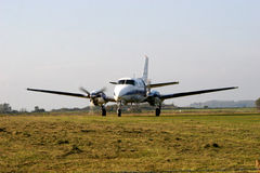 Airplane taxiing. Light aircraft taxiing on grassy airfiel royalty free stock photo