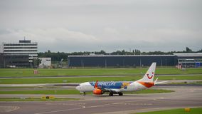 Airplane taxiing before departure. Amsterdam, the Netherlands - July 29, 2017: TUIFly Boeing 737 C-FTOH taxiing before departure, Shiphol Airport, Amsterdam stock footage