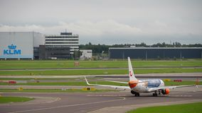 Airplane taxiing before departure. AMSTERDAM, THE NETHERLANDS - JULY 29, 2017: TUIFly Boeing 737 C-FTOH taxiing before departure, Shiphol Airport, Amsterdam stock video footage