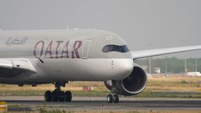 Airplane taxiing before departure. FRANKFURT AM MAIN, GERMANY - JULY 19, 2017: Qatar Airways Airbus 350 A7-ALL taxiing before departure at runway 18. Fraport stock footage