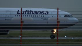 Airplane taxiing after landing. DUSSELDORF, GERMANY - JULY 24, 2017: Lufthansa Airbus 330 D-AIKG taxiing after landing at rain early morning. Dusseldorf airport stock video