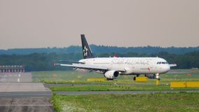 Airplane taxiing after landing. DUSSELDORF, GERMANY - JULY 22, 2017: Turkish Airlines Airbus A321 TC-JRL in Star Alliance livery taxiing after landing, slow stock footage