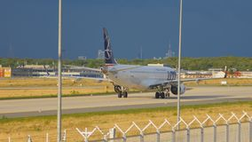 Airplane taxiing after landing. FRANKFURT AM MAIN, GERMANY - SEPTEMBER 5, 2015: LOT Embraer 195 SP-LNE taxiing after landing. Unofficial spotting on Sep. 5, 2015 stock footage