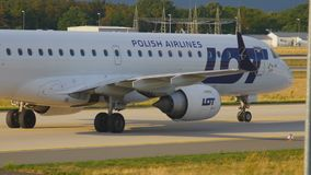 Airplane taxiing after landing. FRANKFURT AM MAIN, GERMANY - SEPTEMBER 5, 2015: LOT Embraer 195 SP-LNE taxiing after landing. Unofficial spotting on Sep. 5, 2015 stock video