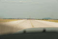 Airplane taxiing on the runway. preparing departure - take off a Royalty Free Stock Photography