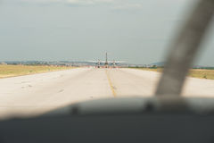 Airplane taxiing on the runway. preparing departure - take off a Royalty Free Stock Images