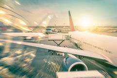 Airplane at the terminal gate in international airport royalty free stock image