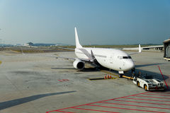 Airplane at the terminal gate ready for takeoff in modern intern royalty free stock photo