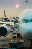 Airplane at the terminal gate ready for takeoff in modern intern Stock Image