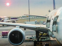 Airplane at the terminal gate ready for takeoff in modern intern Royalty Free Stock Photography