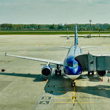 Airplane at the terminal gate ready for takeoff Royalty Free Stock Image