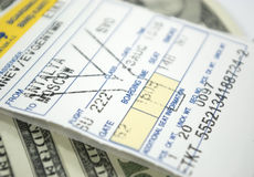 Airplane Ticket And Dollars Stock Images