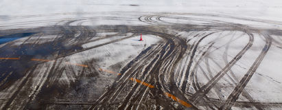 Airplane tire track on snow Royalty Free Stock Photo