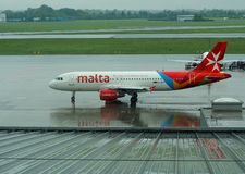 Airplane to Malta. The passenger plane of the Maltese airlines is being flown to departure from the F. Chopin airport in Warsaw Stock Photo