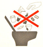 Airplane Toilet Signage. Specifying No Garbage to be Thrown Inside royalty free stock image