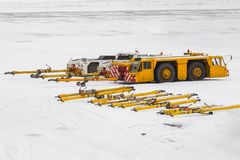 Airplane tow tractor at the parking at the apron of airport winter. Airplane tow tractor at the parking at the apron of airport winter Stock Photo