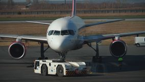 Airplane tows to the parking place