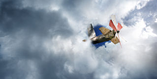 Airplane toy in the cloudy sky. Stock Photo