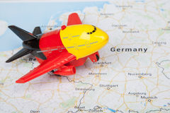 Airplane toy, landed on the europe map. Travel concept Royalty Free Stock Photography