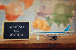 Airplane toy next to blackboard. vintage filtered image. Selective focus royalty free stock photography
