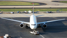 Airplane being towed Stock Photography