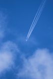 Airplane trails. With a blue sky background Stock Photo