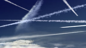 Airplane trails. Crossing each other in an intense blue sky stock video