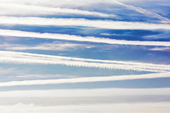 Airplane trails and lines in blue sky. Airplane trails and lines in bright blue sky Stock Photos